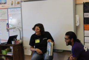 Global Citizenship perform community service. Student Erika reads as Jose looks on.