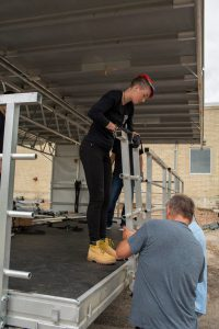 Rhaelee Gronholz setting up for a live event.