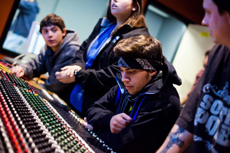 Audio production & engineering college students at work in studio at IPR.