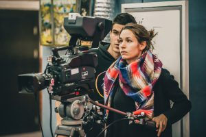Female cinematographer making a movie